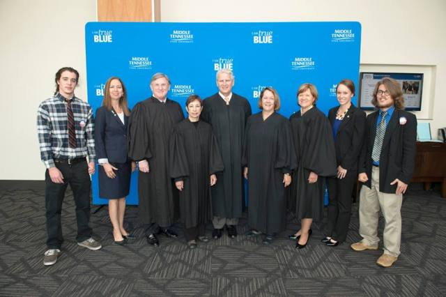 L to R: Spencer Sherrill, Dr. Mary Evins, Justice William Koch, Justice Janice Holder, Chief Justice Gary Wade, Justice Cornelia Clark, Justice Sharon Lee, Amanda Barry, and Josh Moore. The justices heard three cases on MTSU's campus in October 2013 as a part of Supreme Court Advancing Legal Education for Students (SCALES).