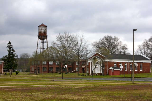 The historic water tower (c. 1900), Bush Chapel (1926), and Graves Mechanical Arts Building (1929) at the Alabama Boys' Industrial School.