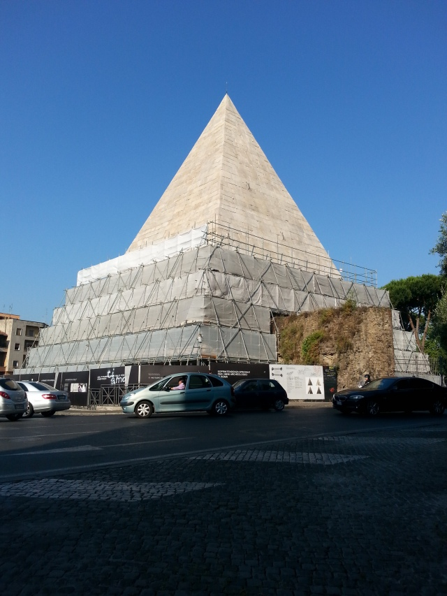 Scaffolding surrounds the lower half of the Pyramid of Cestius, a first-century B.C.-era tomb that now stands partially within the Non-Catholic Cemetery in Rome (http://www.cemeteryrome.it/).  When touring the cemetery with Dr. Nicolas Stanley-Price, he explained that the monument's cleaning was being funded entirely by a wealthy Japanese businessman.