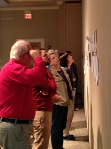 Teachers participate in a gallery walk exploration of primary source material.