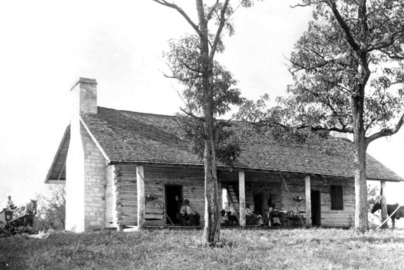 The family of Bob Greene, renowned horse trainer at Belle Meade, at Harding Cabin at about the turn of the twentieth century. Courtesy of the Tennessee State Library and Archives.