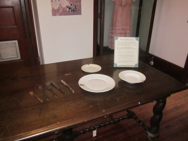 "One of the interactive components, ""Knowing Their Place,"" invited visitors to try their hand at arranging a place setting using period instructions."
