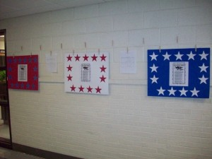 I took the students' stars and mounted them on red, white, and blue poster board with a song sheet in the middle of each poster. These were then hung in the hallway.