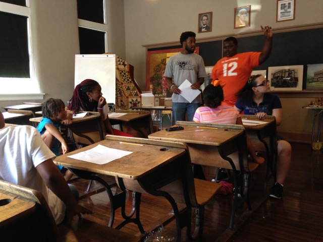 Community volunteer and artist Dominique Coleman asked area children to talk about their artwork during an art camp in July.