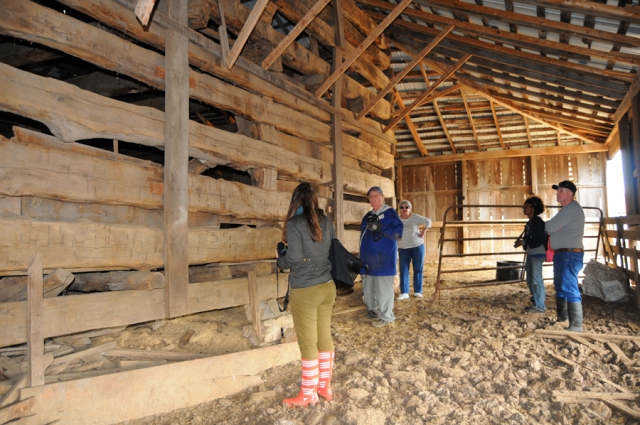 From left to right: Noel Harris, Dr. Carroll Van West, Alice Murphree, Tiffany Momon, and Donnie Boonie inspect the southeast elevation of the Crider corncrib.
