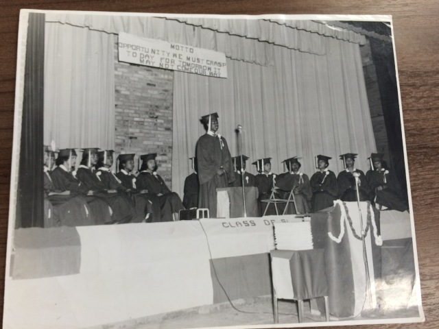"""Webb High School Graduation, most likely 1951. The motto reads, """"Opportunity we must grasp today, for tomorrow it may not come our way."""" Photo courtesy of Webb Alumni Association."""