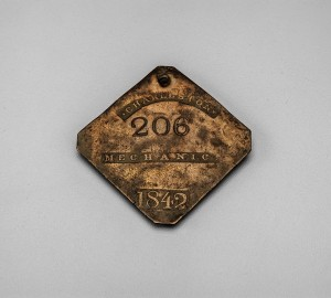 """An 1842 Slave Badge marked """"Mechanic,"""" currently on display at the Museum of Early Southern Decorative Arts."""
