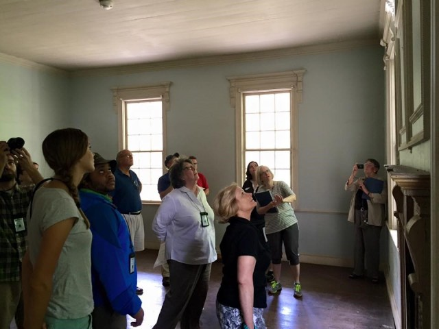 MESDA summer institute participants examining architectural details in Charleston.